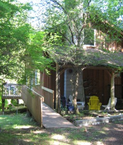 Photo of the side of the Holly House at Hypatia-in-the-Woods showing the ramp entrance.