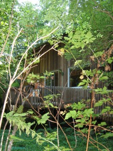 Photo of the back side of the Holly House at Hypatia-in-the-Woods