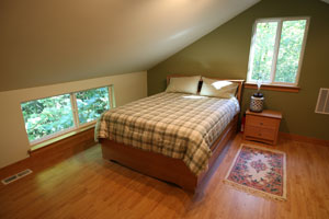 Photo of loft bedroom at the Holly House at Hypatia-in-the-Woods