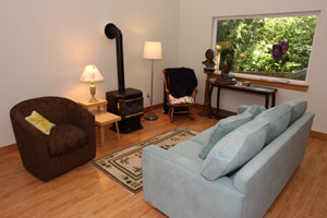 Photo of living room area in the Holly House at Hypatia-in-the-Woods