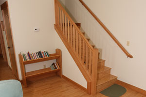 Photo of stairs leading to loft bedroom at the Holly House at Hypatia-in-the-Woods
