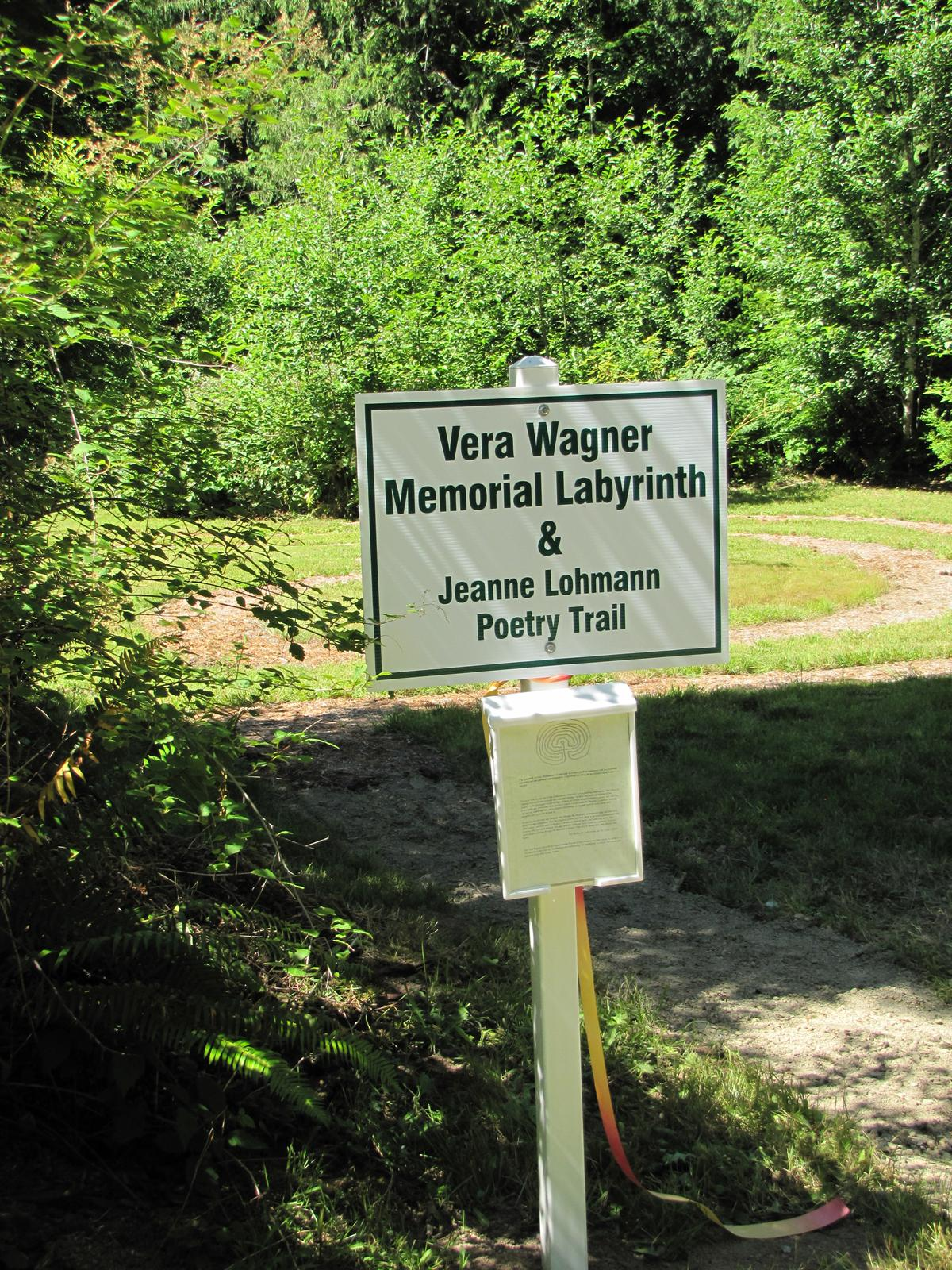 Photo of sign for poetry trail at Hypatia-in-the-Woods